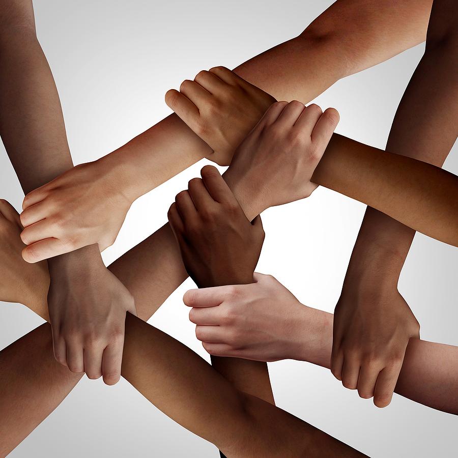diverse group of interlocking hands